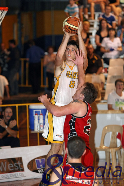 270310GGPRK4896 SBL - Goldfields Giants vs Perth Redbacks Giants' forward Lordan Franich shoots over Redbacks centre Daniel Maddox. Photo: Travis Anderson - Andmedia/Sports Vision ©2010.