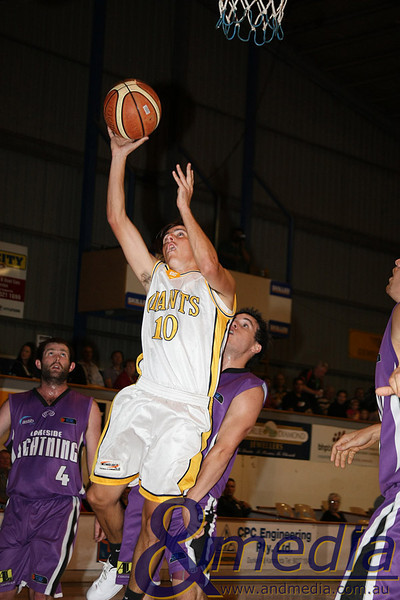 080510GGLL0064 SBL - Goldfields Giants vs Lakeside Lightning Giants' guard Ryan Hulme puts up the layup attempt ahead of Lakeside guard Chris Sofoulis. Photo by Travis Anderson - Andmedia ©2010.