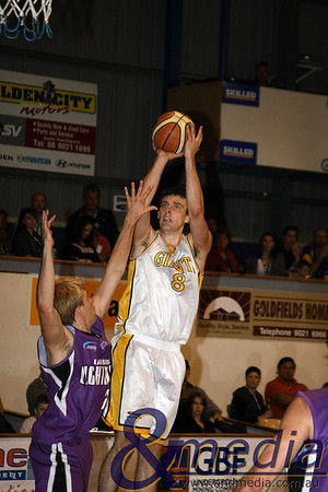 080510GGLL0108 SBL - Goldfields Giants vs Lakeside Lightning Giants' forward Lordan Franich shoots over Lakeside import Luke Payne. Photo by Travis Anderson - Andmedia ©2010.