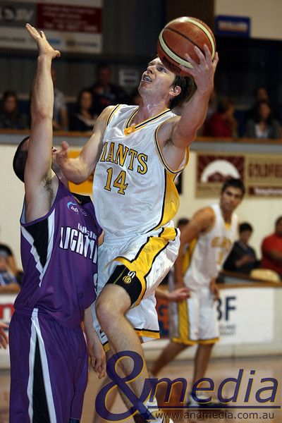 080510GGLL0031 SBL - Goldfields Giants vs Lakeside Lightning Giants' swingman Matthew Leske drives to the basket against Lakeside's Andrew Stock. Photo by Travis Anderson - Andmedia ©2010.