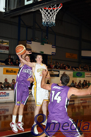 080510GGLL0106 SBL - Goldfields Giants vs Lakeside Lightning Giants' centre Russell Hurst puts up the scoop shot against the defense of Lakeside bigs Benjamin Beran and Jarrad Prue. Photo by Travis Anderson - Andmedia ©2010.