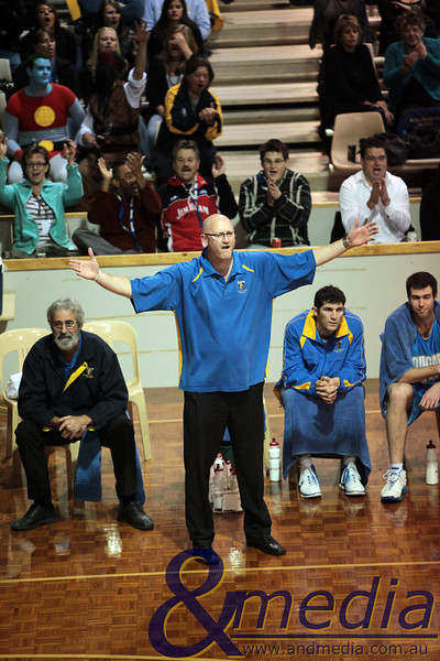 290510GGCC6677 SBL - Goldfields Giants vs Cockburn Cougars - 29th May 2010 Cockburn head coach Stephen Charlton shows his displeasure at a referee's decision much to the delight of the majority of the crowd behind the Cougars' bench. Photo by Travis Anderson - Andmedia ©2010.