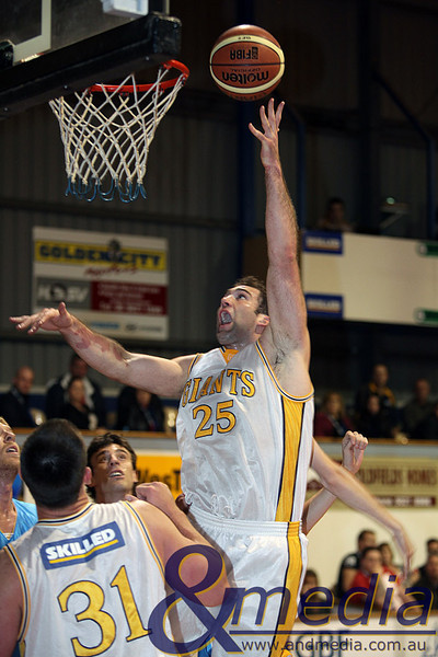 290510GGCC6436 SBL - Goldfields Giants vs Cockburn Cougars - 29th May 2010 Giants' centre John Vaudreuil puts up the left handed hook shot. Photo by Travis Anderson - Andmedia ©2010.