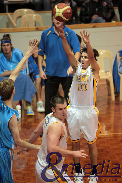 SBL - Goldfields Giants vs Cockburn Cougars - 29th May 2010 290510GGCC6637 SBL - Goldfields Giants vs Cockburn Cougars - 29th May 2010 Giants' guard Ryan Hulme shoots the three pointer over Cougars' forward Gavin Field after getting some help from a Michael Haney screen. Photo by Travis Anderson - Andmedia ©2010.