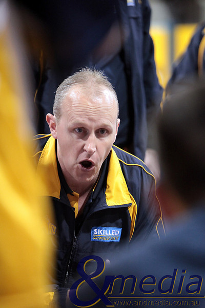 290510GGCC6499 SBL - Goldfields Giants vs Cockburn Cougars - 29th May 2010 Giants' head coach Wayne Creek gets his point across in the team huddle during a time out. Photo by Travis Anderson - Andmedia ©2010.