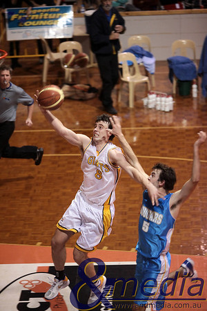 290510GGCC6716 SBL - Goldfields Giants vs Cockburn Cougars - 29th May 2010 Giants' forward Lordan Franich drives to the basket ahead of Cougars' forward Sheldon McIntyre. Photo by Travis Anderson - Andmedia ©2010.