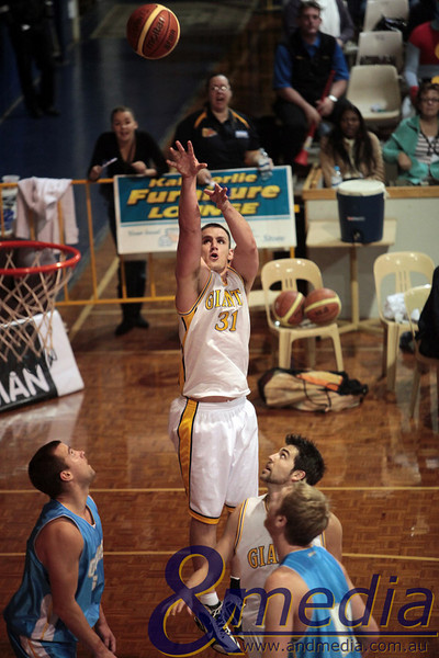 290510GGCC6646 SBL - Goldfields Giants vs Cockburn Cougars - 29th May 2010 Giants' forward Michael Haney puts up the baseline jumpshot. Photo by Travis Anderson - Andmedia ©2010.