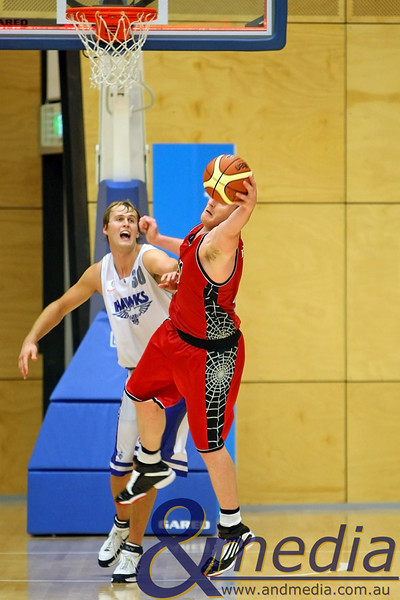 050610PHPR1641 SBL - Perry Lakes Hawks vs Perth Redbacks - 5th June 2010 Redbacks' centre Daniel Maddox hauls in the offensive rebound ahead of Hawks' centre Robert Kempf. Photo by Travis Anderson - Andmedia ©2010.
