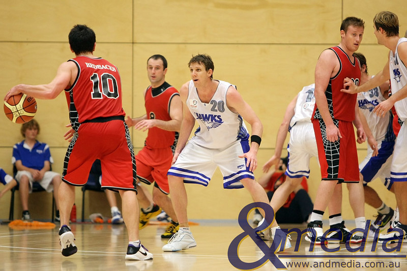 050610PHPR1680 SBL - Perry Lakes Hawks vs Perth Redbacks - 5th June 2010 Hawks' guard Peter Crawford defends Redbacks' guard Joel Wagner as the Redbacks' run through their offense. Photo by Travis Anderson - Andmedia ©2010.