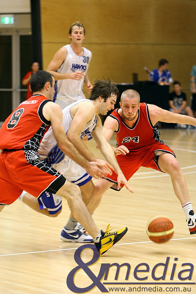 050610PHPR1617 SBL - Perry Lakes Hawks vs Perth Redbacks - 5th June 2010 Hawks' guard Martin Vahala splits the half court defense of Redbacks' defenders Ryan Neill and Jesse Wagstaff. Photo by Travis Anderson - Andmedia ©2010.