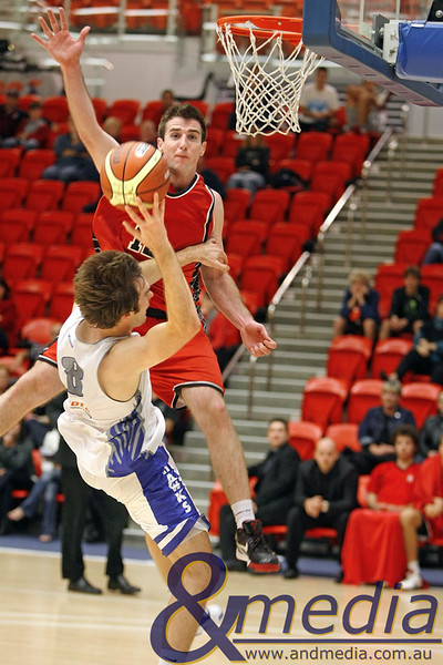 050610PHPR1702 SBL - Perry Lakes Hawks vs Perth Redbacks - 5th June 2010 Redbacks' forward Jarrad Prior skies to block the shot of Hawks' guard Martin Vahala but ultimately gets called for a body foul. Photo by Travis Anderson - Andmedia ©2010.