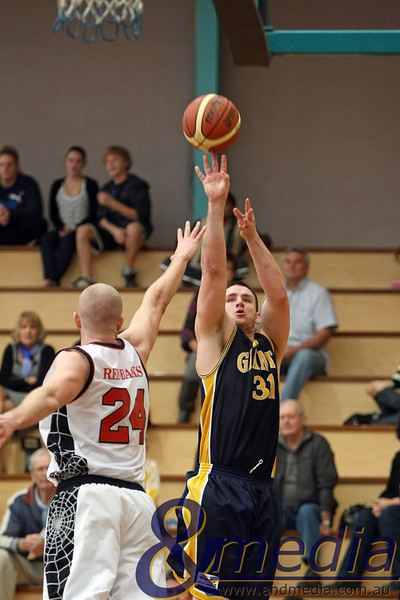 070610PRGG0306 SBL - Goldfields Giants @ Perth Redbacks - 7th June 2010 Giants' forward Michael Haney shoots the baseline jumpshot over Redbacks' forward Jesse Wagstaff. Photo by Travis Anderson - Andmedia ©2010.