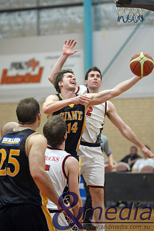 070610PRGG0669 SBL - Goldfields Giants @ Perth Redbacks - 7th June 2010 Giants' swingman Matthew Leske scores the layup against the defense of Redbacks' duo Robbie Cassir and Jarrad Prior on his way to a career high 27 point haul. Photo by Travis Anderson - Andmedia ©2010.