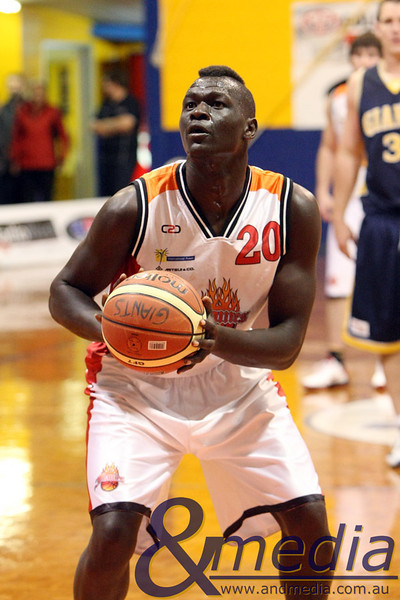 120610GGRF1093 SBL - Goldfields Giants vs Rockingham Flames - 12th June 2010 Flames' centre Chudier Pal lines up the free throw attempt. Photo by Travis Anderson - Andmedia ©2010.