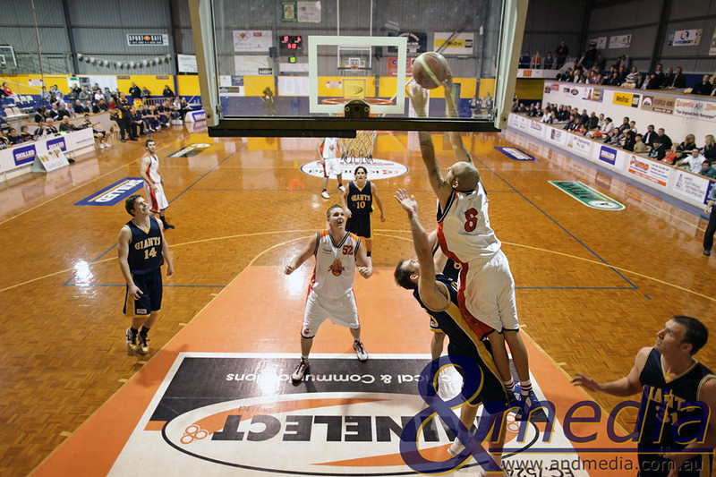 120610GGRF0035R1 SBL - Goldfields Giants vs Rockingham Flames - 12th June 2010 Flames' import Demetrius Hazel goes up for the two-handed dunk attempt over Giants' import John Vaudreuil. Photo by Travis Anderson - Andmedia ©2010.