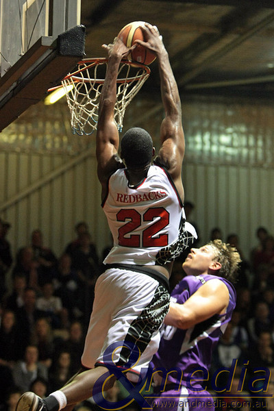130810LLPR0276 SBL - Lakeside Lightning vs Perth Redbacks - Semi Final Game 2: 13th August 2010. Redbacks' forward Jon Meriweather finishes off the alley-oop dunk on Lightning centre Ben Beran. Photo by Travis Anderson - Andmedia ©2010.