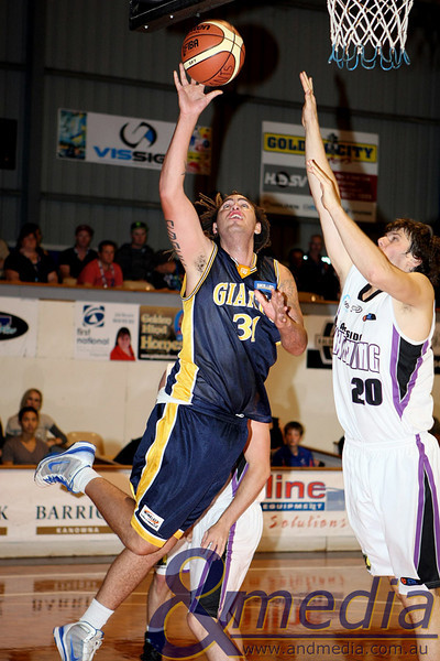 160411GGLL10222 SBL - Goldfields Giants vs Lakeside Lightning Giants' forward Dwayne Radcliffe shoots over Lakeside forward Tom Parkinson. Photo: Travis Anderson - Andmedia/Sports Vision ©2011