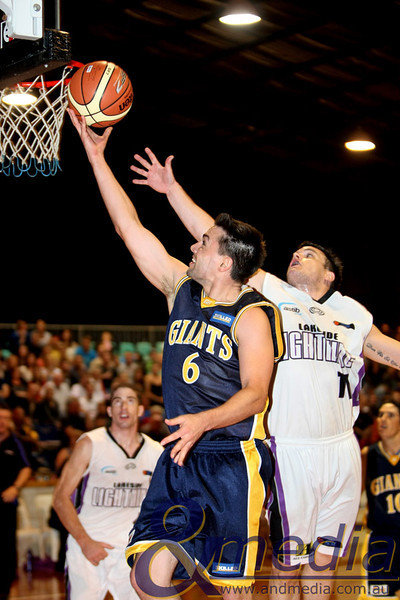 160411GGLL10363 SBL - Goldfields Giants vs Lakeside Lightning Giants' guard Jimmy Bowler lays the ball up ahead of Lakeside guard Chris Sofoulis. Photo: Travis Anderson - Andmedia/Sports Vision ©2011