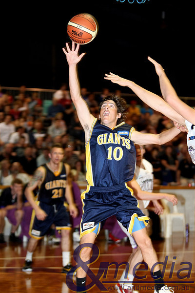 160411GGLL10237 SBL - Goldfields Giants vs Lakeside Lightning Giants' guard Ryan Hulme goes in for the contested layup. Photo: Travis Anderson - Andmedia/Sports Vision ©2011