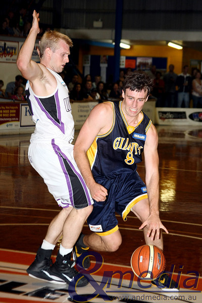 160411GGLL10170 SBL - Goldfields Giants vs Lakeside Lightning Giants' forward Lordan Franich drives on Lakeside guard Luke Payne. Photo: Travis Anderson - Andmedia/Sports Vision ©2011