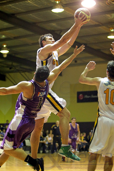 120812kalgiants8supp SBL - Goldfields Giants @ Lakeside Lightning: Quarter Finals game 2 Giants' forward Lordan Franich hauls in the offensive rebound over Lakeside guard Chris Sofoulis. Photo: ANDMEDIA
