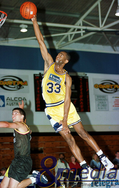 "2000 130500RFGG0126A SBL - Goldfields Giants @ Rockingham Flames - 13th May 2000 Giants' swingman Calvin ""Doc"" Earl soars for the fastbreak dunk over Flames' guard Darren Russell. Photo by Travis Anderson - Andmedia/Pro Sports Images ©2000."