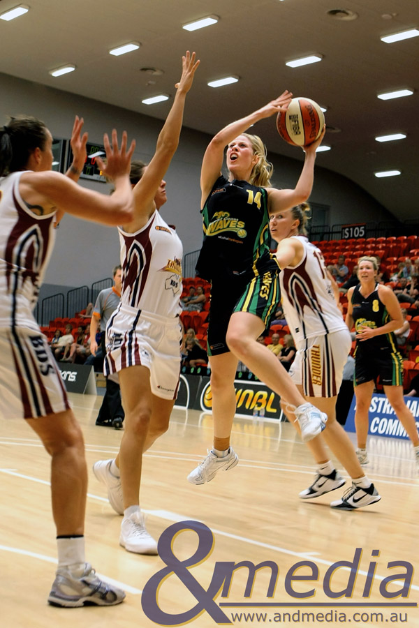 171210WNBL0403 West Coast Waves vs Logan Thunder - 17/12/2010 WA Basketball Centre Waves guard Melissa Marsh puts up the left handed shot over the Thunder defense. Photo: TRAVIS ANDERSON - ANDMEDIA