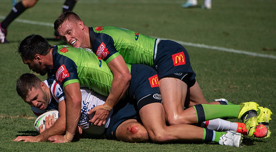 Jack Wighton and Jordan Rapana tackle a Roosters player during the Canberra Raiders trial match against the Sydney Roosters at Seiffert Oval in Queanbeyan.