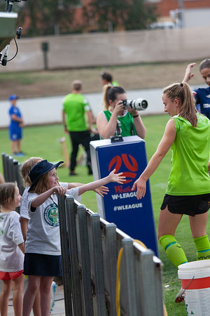 Canberra united kids high five Laura Hughes