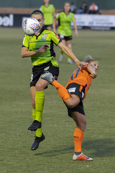Katrina Gorry back heal pass over Olivia Price