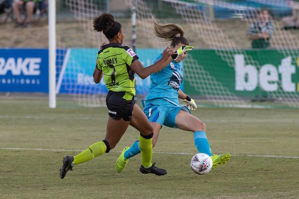 Mackenzie Arnold blocks Simone Charley