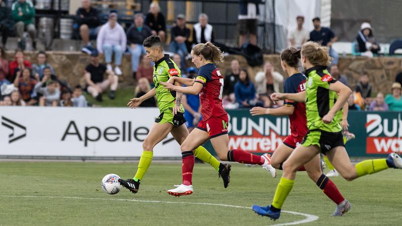 Michelle Heyman sprints past defender