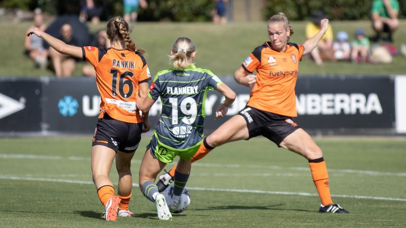 Nicki Flanery sneaky shot at goal between defenders