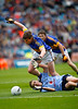 180911  GAA Football All Ireland Minor Championship Final  Dublin v Tipperary .  Conor O'Sulllivan Tipperary  takes evasive action around Paul Mannion Dublin. Photo Andy Jay.