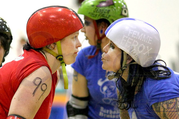 151011BRD21275 Bunbury Roller Derby presents - Mutiny on the Bouty: Barbossa Bruisers vs Polly Rogers @ Eaton Recreation Centre, 15th October 2011. Barbossa Bruisers' pivot Femme Ferox tries her best to psych out opposing pivot Neon D'Fleur as they line up on the pivot line before the jam. Photo: TRAVIS ANDERSON / Andmedia ©2011.