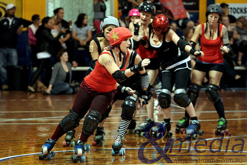 130211GCRD1442<br /> Gold City Roller Derby Presents... The Bloody Valentine Bout - Bleeding Hearts vs Rotten Candy @ Neils Hansen Stadium - 12th February 2011<br /> Bleeding Hearts' jammer Modern Warfare ahead of the pack.<br /> Photo: TRAVIS ANDERSON - Andmedia ©2011.