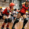 130211GCRD0048<br /> Gold City Roller Derby Presents... The Bloody Valentine Bout - Bleeding Hearts vs Rotten Candy @ Neils Hansen Stadium - 12th February 2011<br /> Kalgoorlie derby girl Shifty Swifty (left) receives a whip from her Bleeding Heart teammate Hot Wheels.<br /> Photo: TRAVIS ANDERSON - Andmedia ©2011.