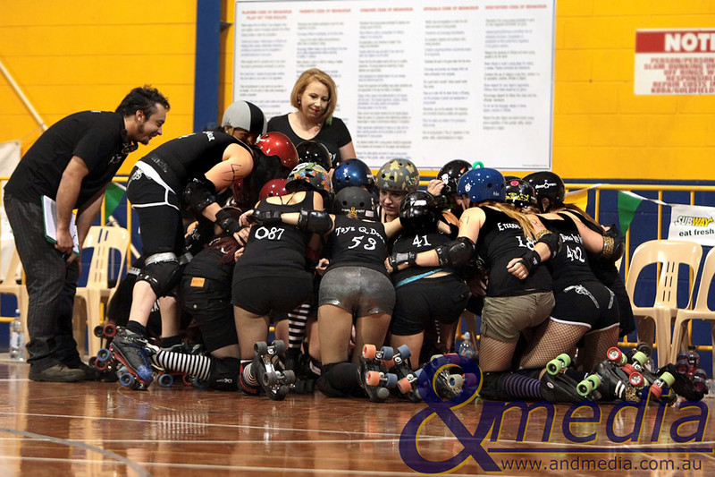 130211GCRD0005 Gold City Roller Derby Presents... The Bloody Valentine Bout - Bleeding Hearts vs Rotten Candy @ Neils Hansen Stadium - 12th February 2011 Rotten Candy with bench manager Sid Down and assistant Fanny Green in their team huddle before the big bout. Photo: TRAVIS ANDERSON - Andmedia ©2011.