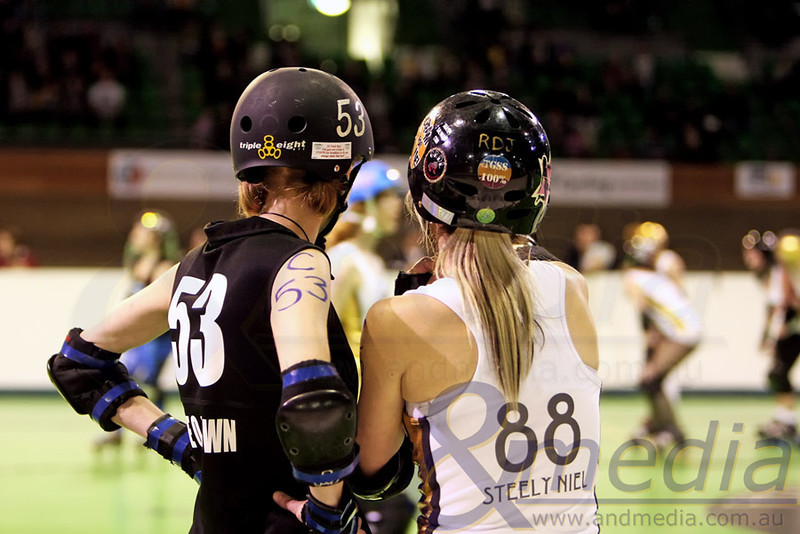 200811WARD0156 WA Roller Derby - Sonic Doom vs Electric Screams @ Midvale Speed Dome, 20th August 2011. Opposing captains Taye Q. Down (Sonic Doom) and Steely Niel (Electric Screams) confer before the bout. Photo: ANDMEDIA ©2011