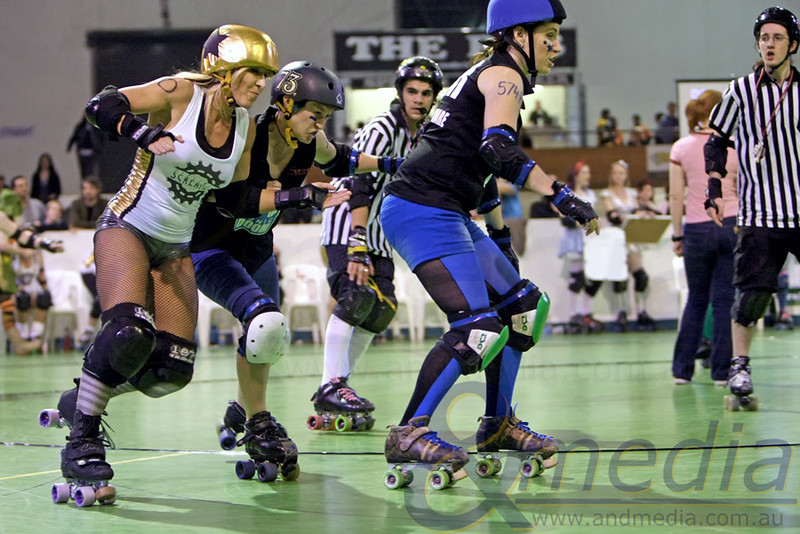 200811WARD0884 WA Roller Derby - Sonic Doom vs Electric Screams @ Midvale Speed Dome, 20th August 2011. Sonic Doom blocker Serenity Pow puts a hit on Electric Screams' jammer Hot Wheels as she takes the outside line. Photo: ANDMEDIA ©2011