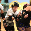 """051010GCRD5888<br /> Gold City Roller Derby training - 5th October 2010<br /> """"Shifty Swifty"""" weaves her way through the pack during the scrimage session.<br /> Photo - Andmedia ©2010."""