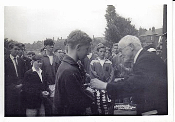 Andrew Wilbey receiving the pennant for the winning Colts' VIII, Midland Schools' Regatta, Northwich 1962