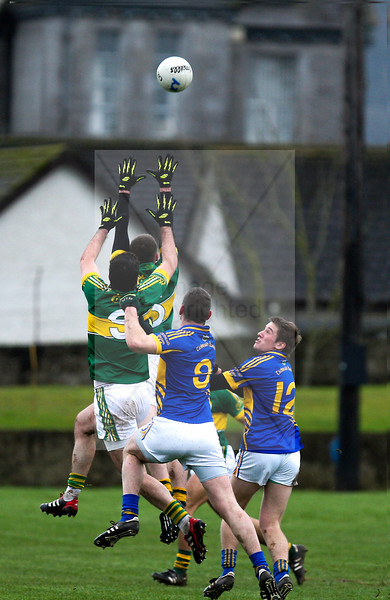 260113  2013 Munster GAA McGrath Football Final  Tipperary v Kerry . Tipperary's  Lorcan Egan and Bill Maher challenge Kerry for the high ball.  Photo Andy Jay.