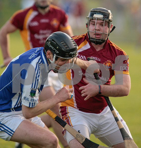 171113 The Munster Club Intermediate Hurling Championship Final Ballina v Youghal. Ballina's Pat Cosgove comes up against Barry Ring . Photo Andy Jay