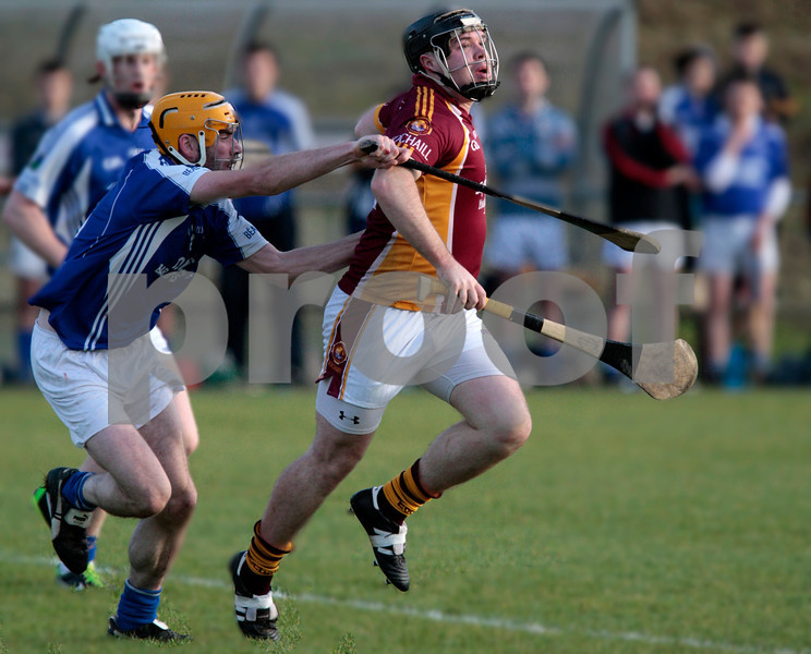 171113 The Munster Club Intermediate Hurling Championship Final Ballina v Youghal.  Andrew Curtin Youghal comes under pressure from  Ballina's Thomas Collins  Photo Andy Jay.