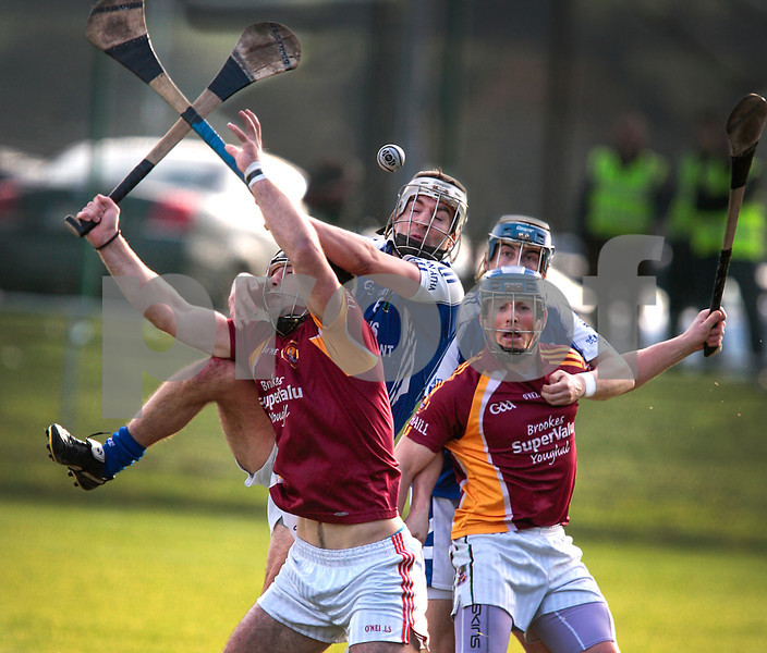 171113 The Munster Club Intermediate Hurling Championship Final Ballina v Youghal. Ballina's Thomas Collins in the thick of it as he clashes with Youghal hurlers during Sunday's final played in Mallow.  Photo Andy Jay