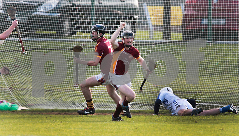 171113 The Munster Club Intermediate Hurling Championship Final Ballina v Youghal.  Youghal goalie Richard Cunningham is unable to stop a goal by Ballina's     ( ????) in the third minute. Donal Kent and TJ O'Connell show their delight at the early Score.  Photo Andy Jay.