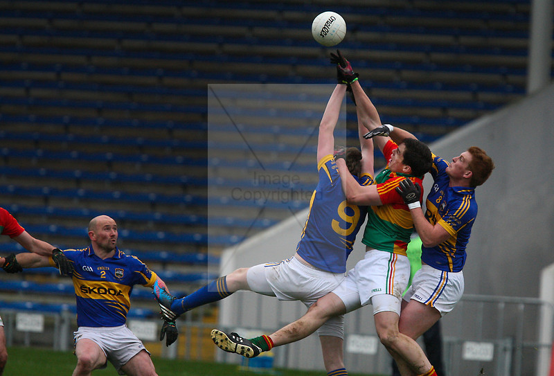 030213 Allianz Football League Division 4 Round 1.  Tipperary v Carlow.    Barry John Molloy Carlow, battles with Tipperary's George Hannigan and partner during Sunday's game played in Thurles. Photo Andy Jay.