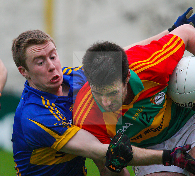 030213 Allianz Football League Division 4 Round 1.  Tipperary v Carlow.  Tipperary's  Brian Fox tackles Carlow's  Eoghan Ruth during Sunday's First Round division Four Alllianz league game played in Thurles.  Photo Andy Jay.