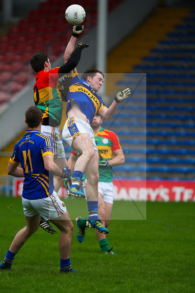 030213 Allianz Football League Division 4 Round 1.  Tipperary v Carlow.  Tipperary's Peter Acheson is watched by his colleague Alan Maloney as he goes up for a high ball.  Photo Andy Jay.